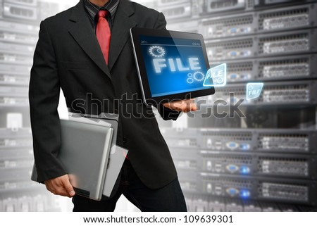 Programmer keep data file in data center room service - stock photo