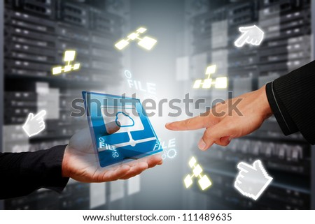 Programmer 's hands in data center room with file system service - stock photo