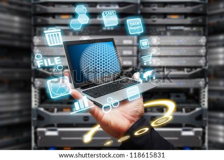 Programmer take control the digital file in data center room - stock photo