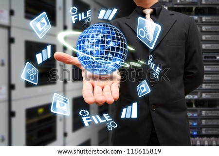 Programmer take control the digital world in data center room : Elements of this image furnished by NASA - stock photo