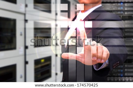 Programmer touch on power button - stock photo