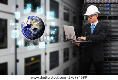 Programmer working on digital world with laptop : Elements of this image furnished by NASA - stock photo