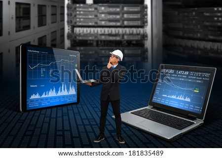 Programmer working with digital devices - stock photo