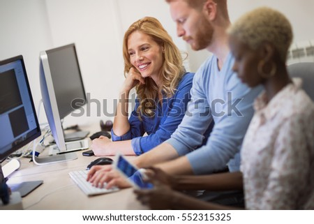 Programmers and business people collaborating in company office