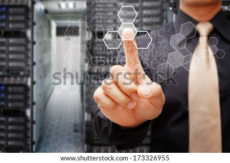 Programmers in data center room and touch the power button - stock photo