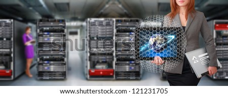 Programmers in data center room : Elements of this image furnished by NASA