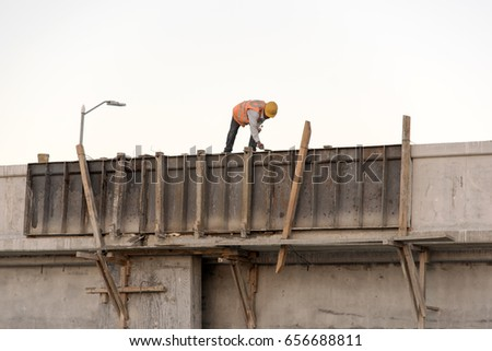 PROGRESO, MEXICO - JANUARY 27,2017: Worker doing repair work at the longest pier in the world in Progreso Mexico January 27 2017