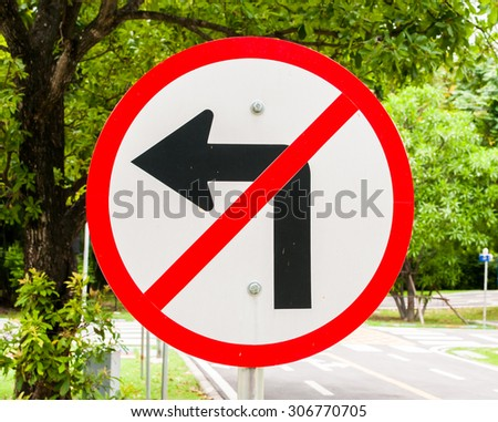 Prohibition  no Left turn signs  with natural bachground - stock photo