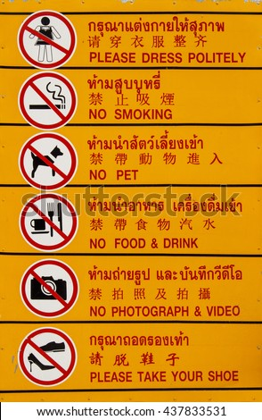 prohibition signs, thai languages, chinese languages, english, please dress politely, no smoking, no pet, don't eat, no photograph and video, please take off your shoes. - stock photo