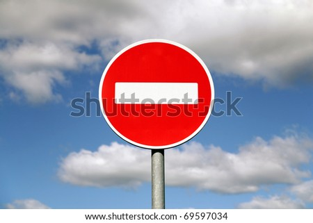 Prohibition traffic sign against the sky with clouds - stock photo
