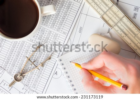 Project development, writing new data to a notebook after measurement - stock photo