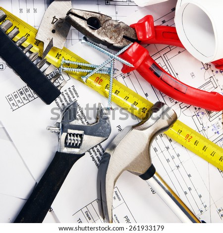 project drawings  and tools on table - stock photo