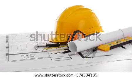 Project drawings and yellow helmet isolated on white - stock photo