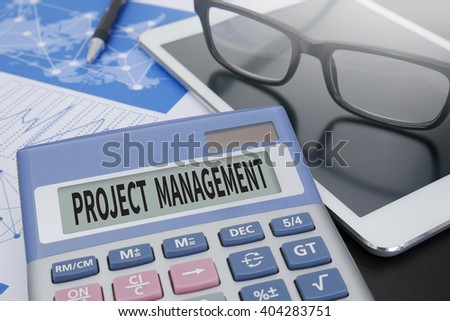 PROJECT MANAGEMENT Calculator  on table with Office Supplies. ipad - stock photo