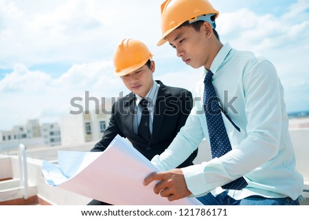 Project managers supervising the construction site - stock photo