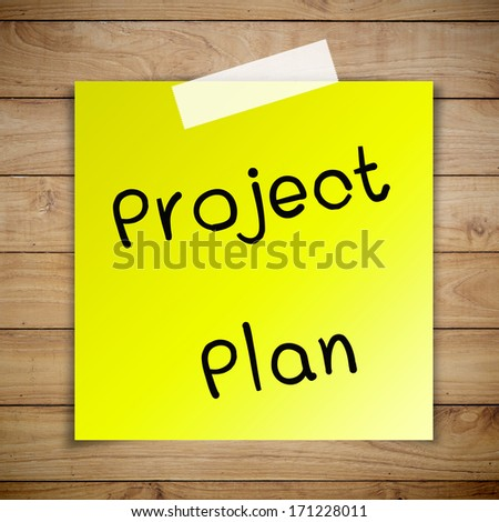 Project plan on sticky paper on Brown wood plank wall texture background - stock photo
