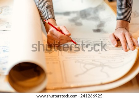 Projecting with pencil on the big urban drawings. Town planning - stock photo