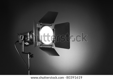 Projector lights with space for your text - stock photo