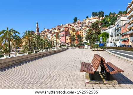 Promenade along streets and colorful houses of Menton - town and touristic resort on French Riviera. - stock photo