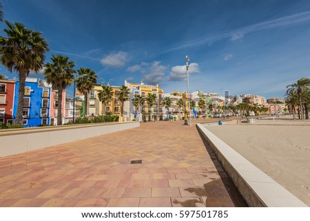 Promenade and beach in colorful village of Villajoyosa in Spain on Costa Blanca