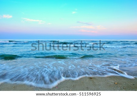 promenade at sunset with soft waves