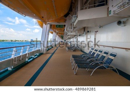 Promenade Deck showing life boats and blue water