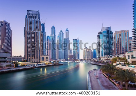 Promenade in luxury Dubai Marina with modern skyscrapers in the evening,Dubai,United Arab Emirates - stock photo