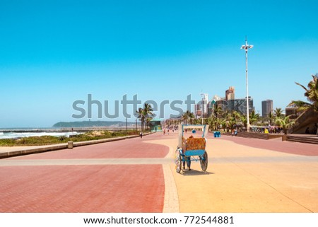 Promenade of Durban bay of plenty  with traditional rickshaw driving on it