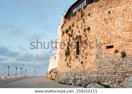 Promenade on ancient outer walls of the White Town Ostuni during sunset