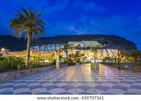 Promenade to the beach in Taurito at dusk, Gran Canaria island in Spain - stock photo