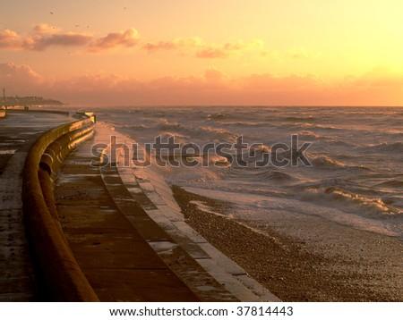 Promenade with rough sea - stock photo