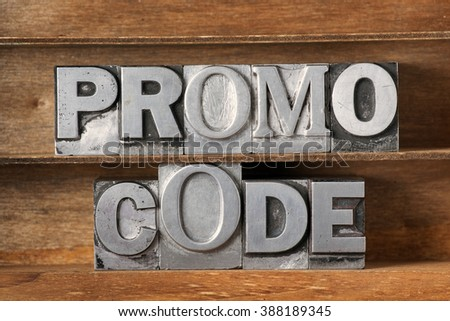 promo code phrase made from metallic letterpress type on wooden tray