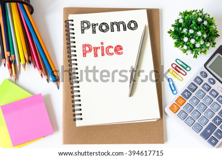 promo price text message on white paper and office supplies, pen, paper note, on white desk , copy space / business concept / view from above, top view - stock photo