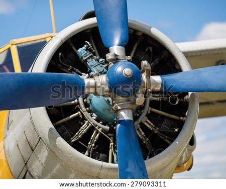 Propeller and airplane engine close-up. Shallow depth of field. Selective focus on propeller. - stock photo