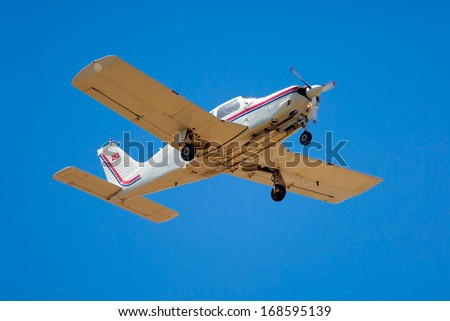 propeller driven airplane in flight - stock photo