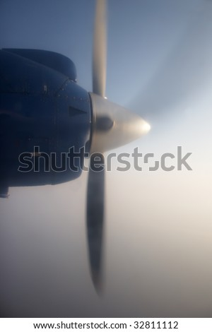 Propeller of a flying plane - stock photo
