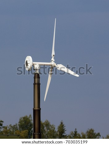 Propeller of bladed wind generator of a mobile power station on a metal support