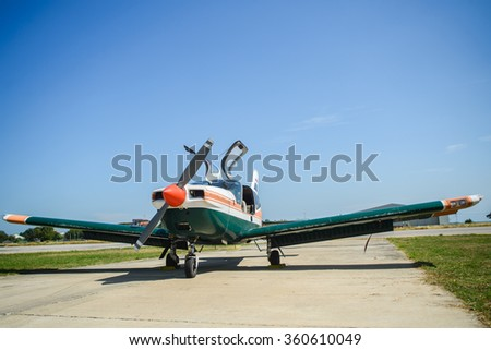 Propeller plane parking at the airport in sunny day - stock photo