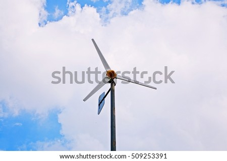 propeller windmill, with fluffy clouds on blue sky, Renewable energy, symbolizing as sustainability and  green power
