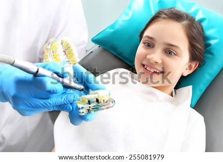 Proper brushing, child dentist. Child in the dental chair dental treatment during surgery. - stock photo