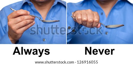Proper way to hold a spoon concept - stock photo