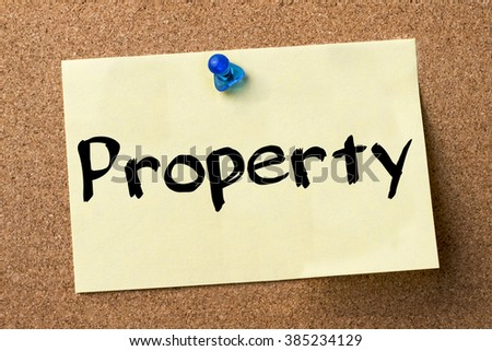 Property - adhesive label pinned on bulletin board - horizontal image - stock photo