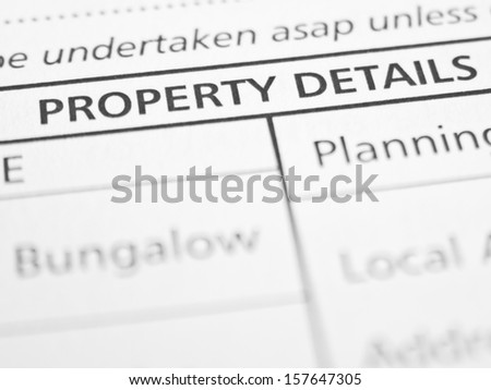 PROPERTY DETAILS written on a form or contract close up. - stock photo