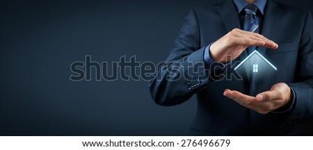 Property insurance and security concept. Protecting gesture of man and symbol of house. Wide composition.  - stock photo
