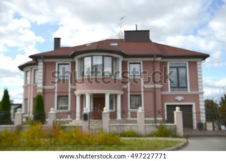 property residential house building on sunset, image blur background