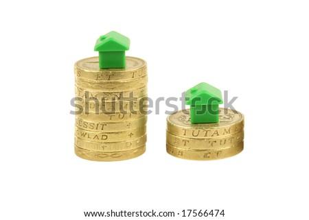 Property stock market crash, pound coins, houses, isolated on a white background - stock photo