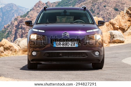 Propriano, France - July 5, 2015: Dark purple new Citroen C4 Cactus on the mountain road of Corsica island - stock photo