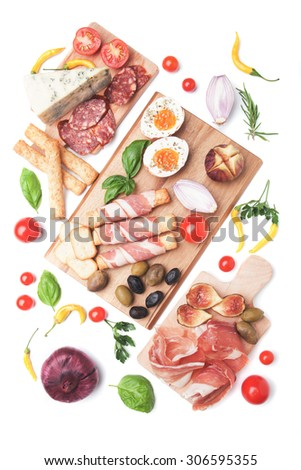 Prosciutto di Parma with olives and other italian antipasto food isolated on white background - stock photo