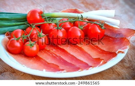 Prosciutto (ham), cherry tomatoes and onion - stock photo