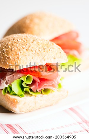 Prosciutto sandwich on plate close up. Selective focus, shallow DOF